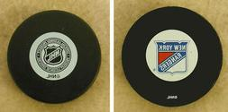 LOT OF 2 HOCKEY PUCKS -NHL OFFICIAL IN GLAS CO - NEW YORK RA